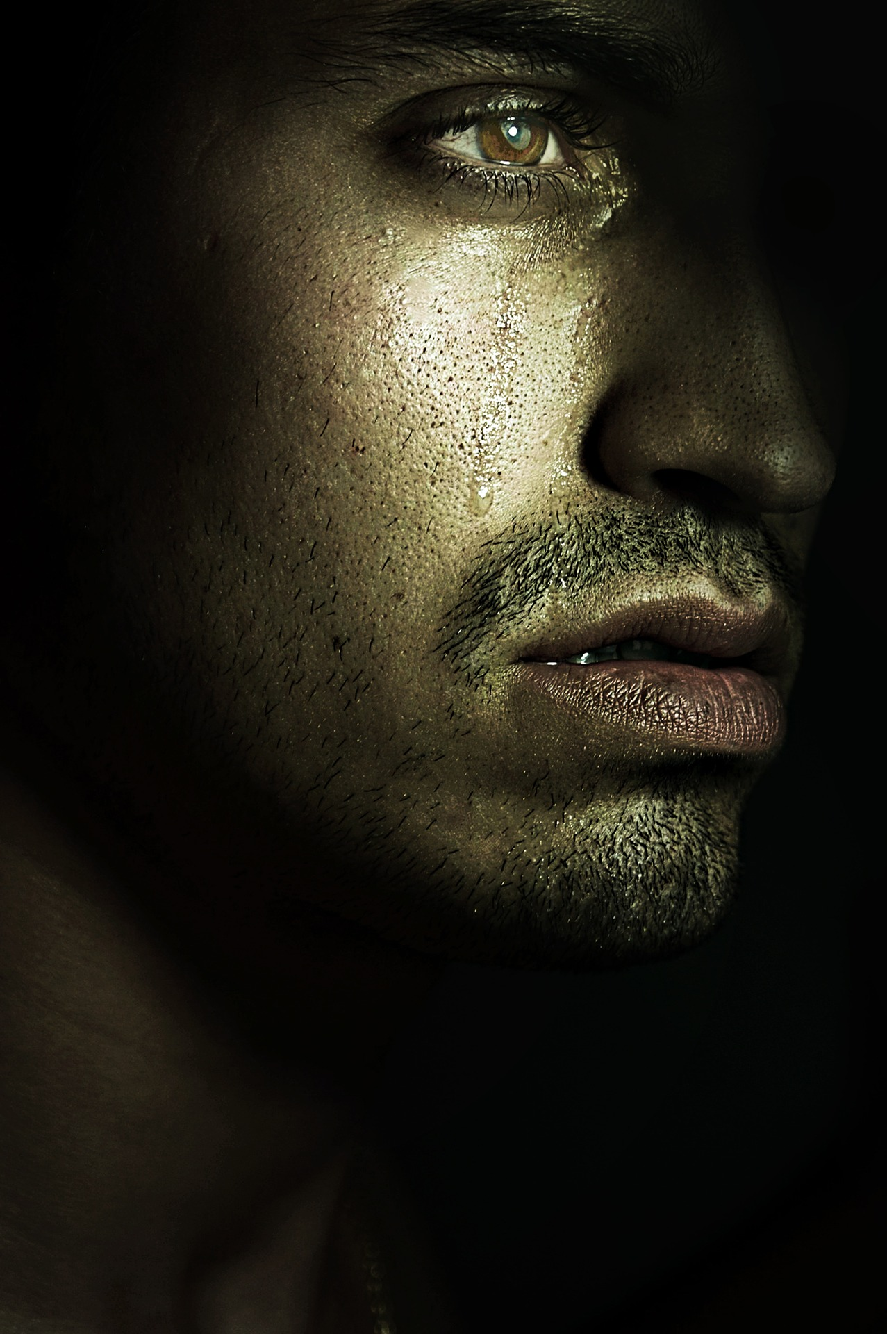 profile of a man crying